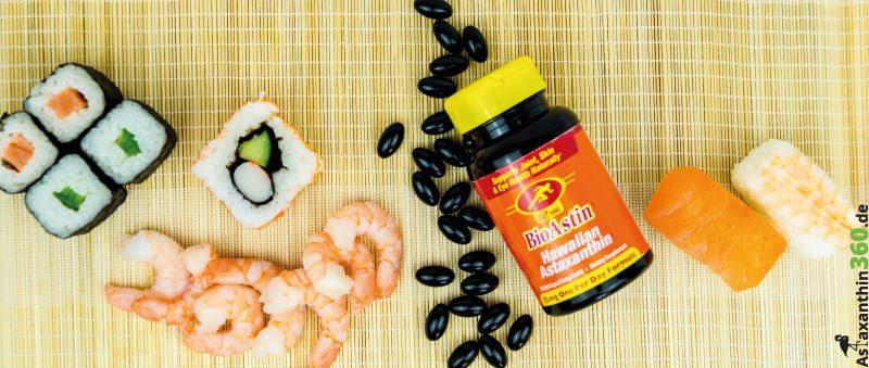 Fisch, Sushi und eine BioAstin-Dose mit Kapseln